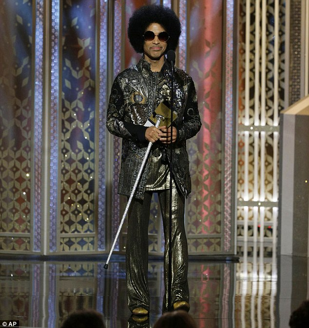 249D09DB00000578-0-Walking_stick_The_Purple_Rain_singer_wore_a_metallic_outfit_and_-m-52_1421030790941